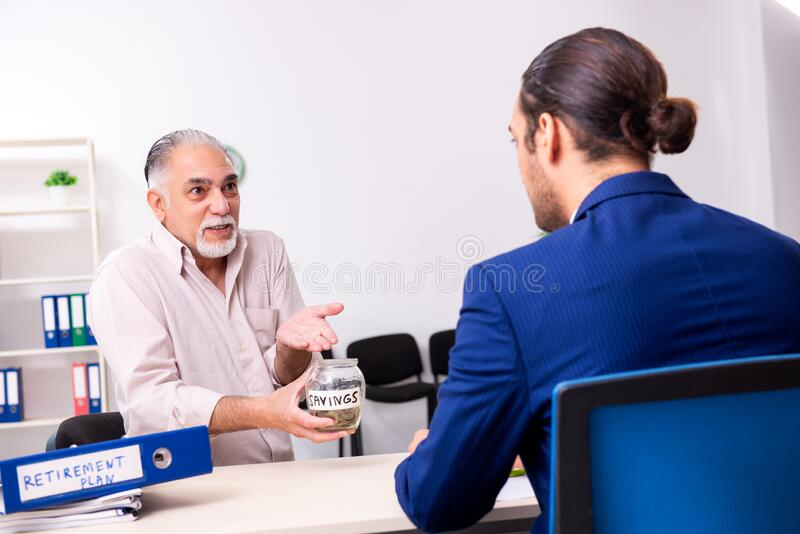 Financial advisor giving retirement advice to old man royalty free stock images