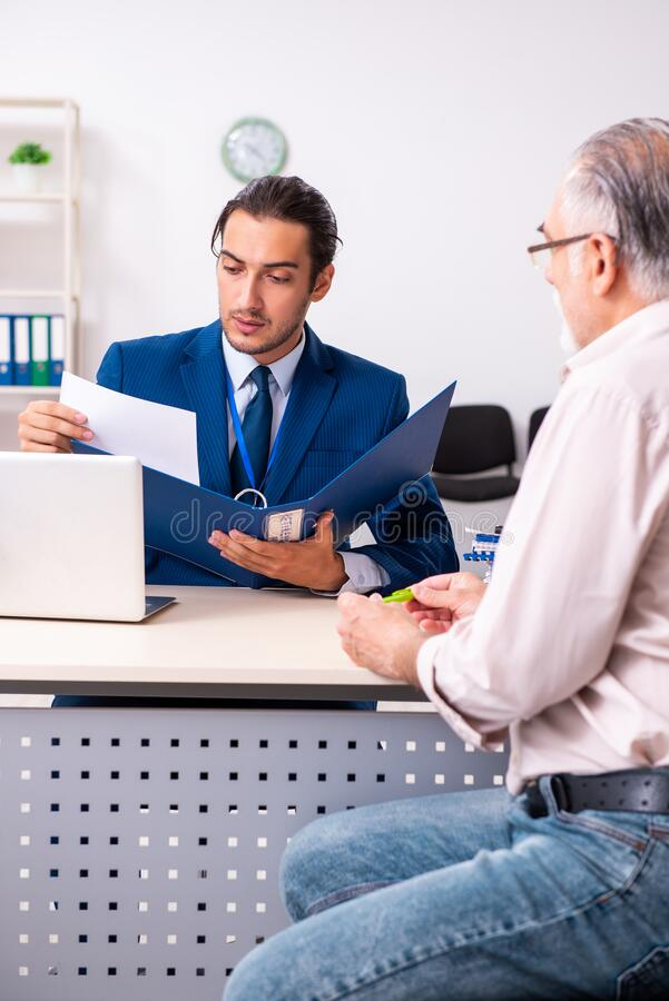 Financial advisor giving retirement advice to old man stock photo