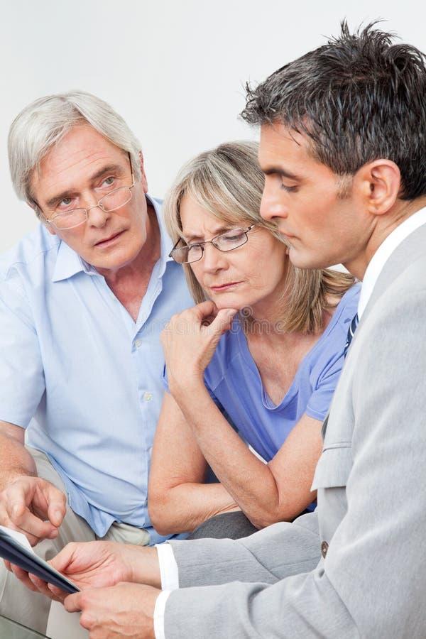 Download Financial Advisor Talking To Senior Stock Photo - Image: 23362700