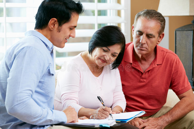 Download Financial Advisor Talking To Senior Couple At Home Stock Image - Image: 29054419