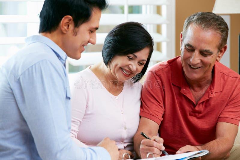 Download Financial Advisor Talking To Senior Couple At Home Stock Photo - Image: 29054462