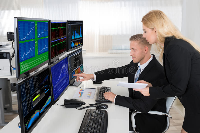 Financial Agents Monitoring Computer Screens In Office royalty free stock photos