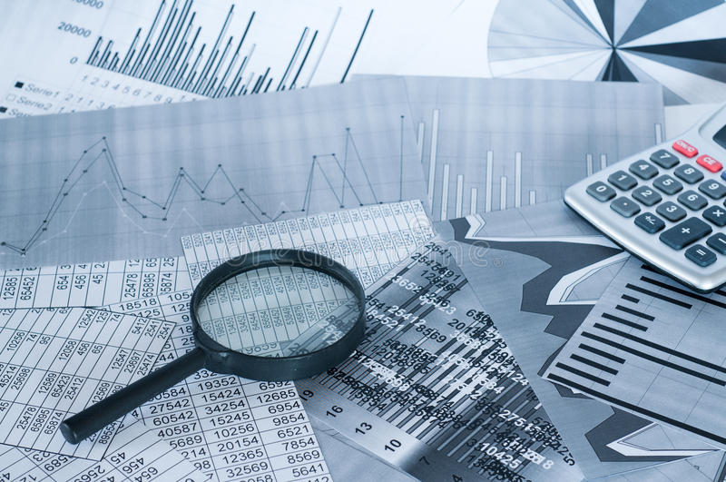 Financial analysis. Simulation financial analysis calculator and magnifier stock photos