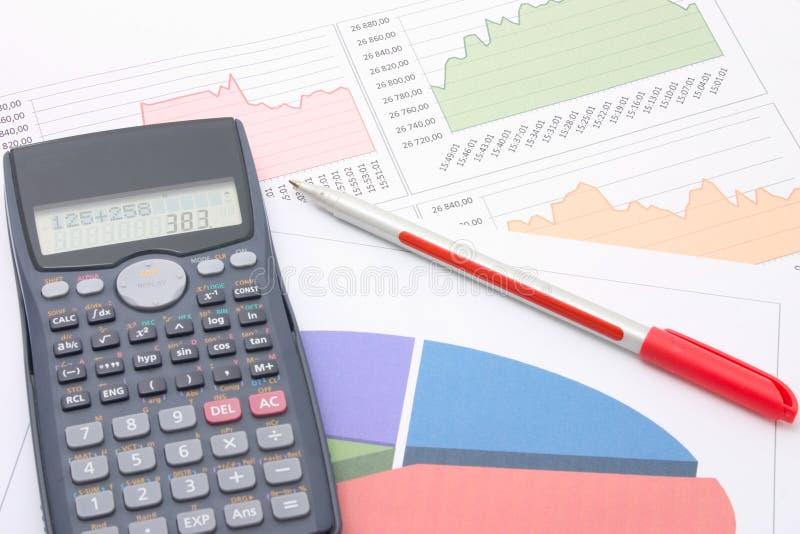 Financial analysis. Photograph of a calculator, financial figures and pen stock photos