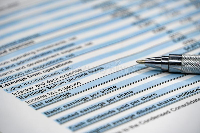 Financial analysis - income statement, business plan with glass. Business composition. Financial analysis - income statement, business plan with pen, finance stock images