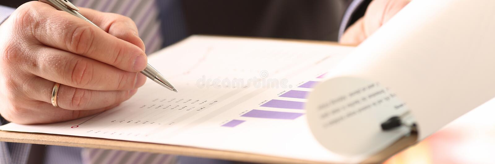 Financial Auditor Signing Calculating Document. Consulting Business Man. Profit Accounting with Color Graph. Audit Inspection and Calculating Investment stock image