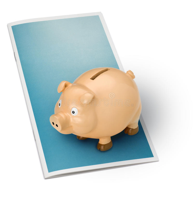 Financial Brochure Piggy Bank. A blank brochure with a piggybank on top, isolated on white royalty free stock photography