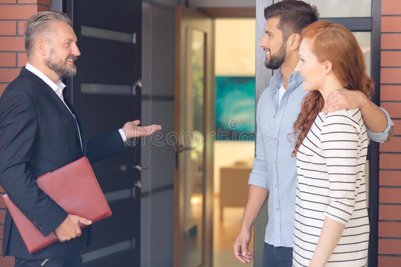 Financial broker inviting clients stock image