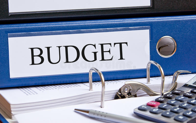 Financial budget. Financial concept image with blue budget binder, calculator and pen stock images