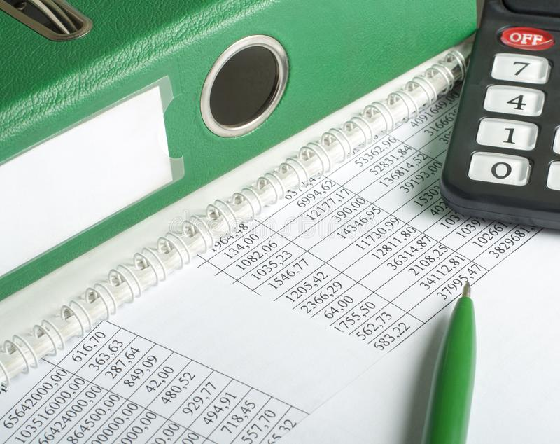 Financial and budget concept. Calculator, pen, accounting books and financial document on office table royalty free stock photos
