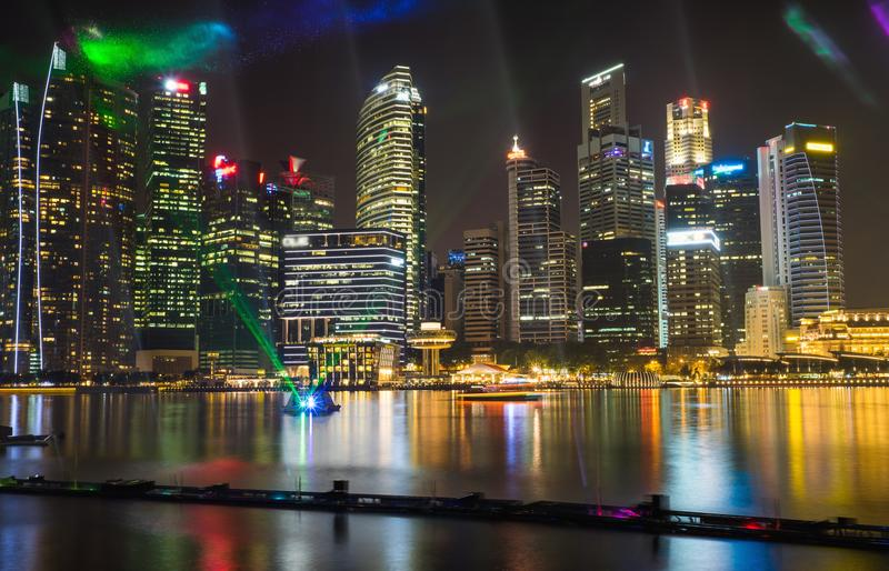Financial and business buildings at Marina Bay with music and light show on foreground.  stock photos