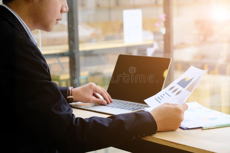 Financial business concept, Businessman research income statement data from spreadsheets, Audit man working. stock photos