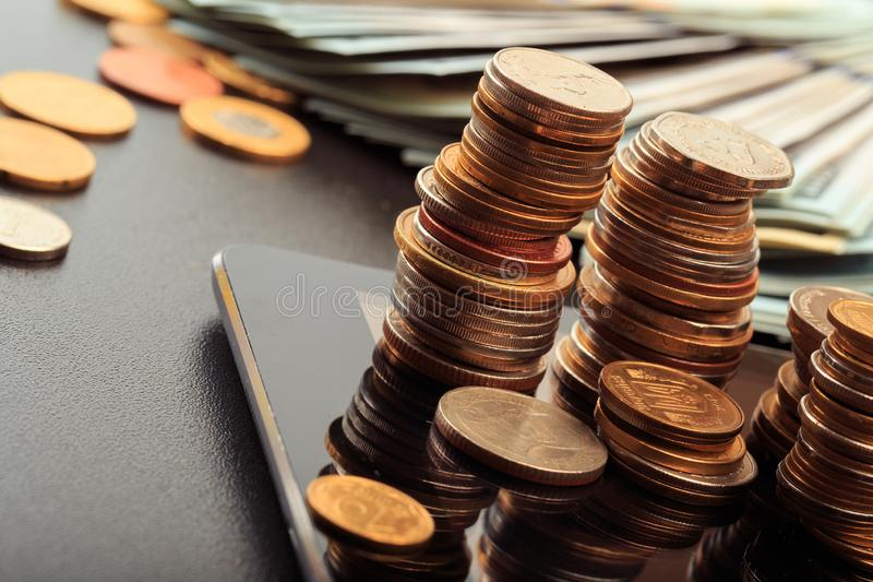 Financial business concept combination with coins, money, calculator and pen royalty free stock photography