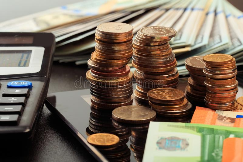 Financial business concept combination with coins, money, calculator and pen royalty free stock photo