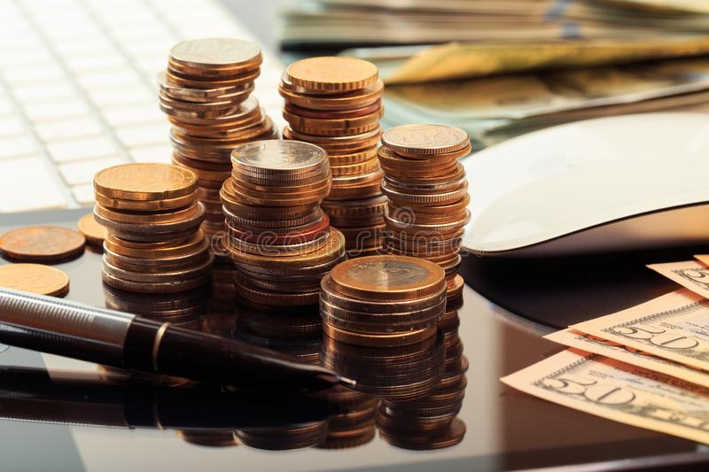 Financial business concept combination with coins, money, calculator and pen stock image
