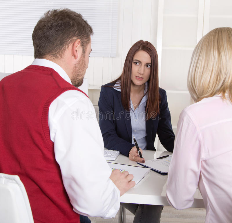 Financial business meeting: young married couple - adviser and c royalty free stock photography
