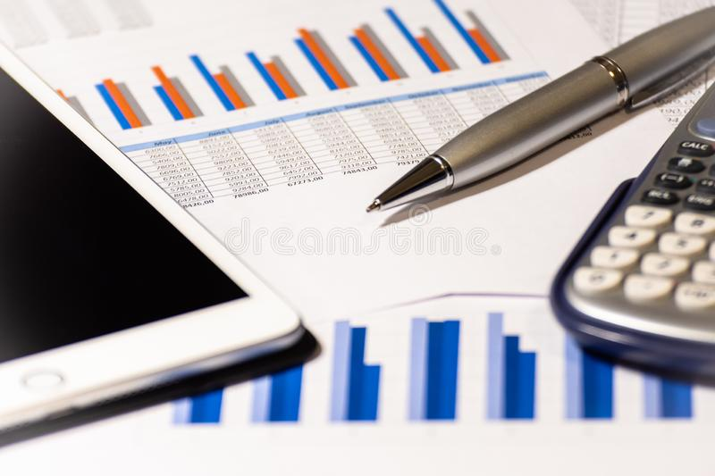 Financial and business report. Calculator, pen and tablet stock photography
