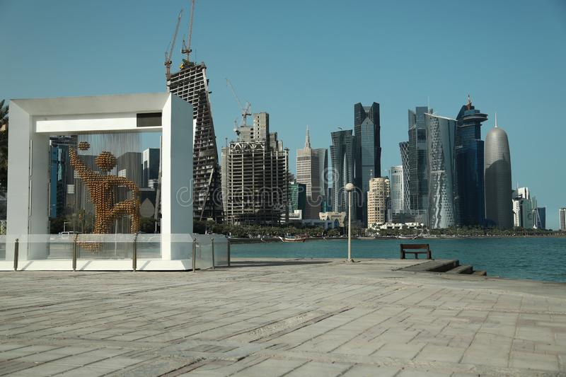 Financial centre in Doha city, Qatar. QATAR, DOHA, MARCH 20, 2018: Corniche road and financial centre in Doha city, Qatar. View on skyscrapers in Doha downtown stock images