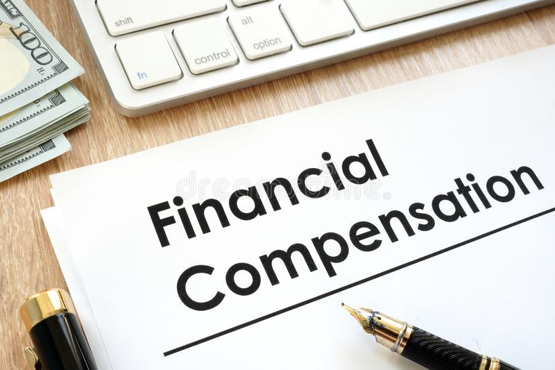 Financial Compensation document. Financial Compensation document on a table stock image