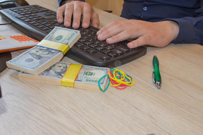 Financial concept. Make money on the Internet. Businessman working with laptop in office stock image