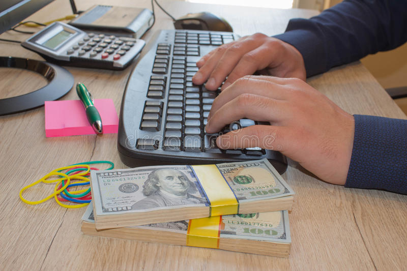 Financial concept. Make money on the Internet. Businessman works at office royalty free stock photos