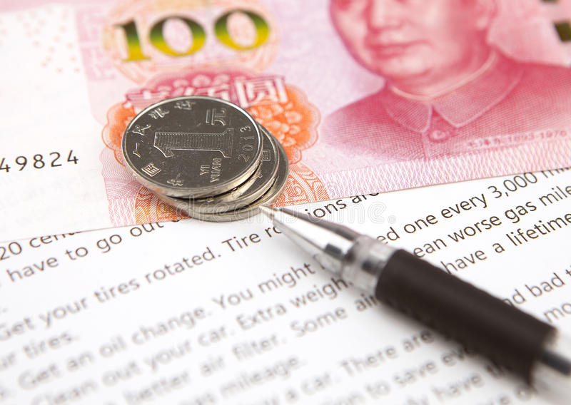 Financial concept. Financial paper, chinese currency and pen royalty free stock photos