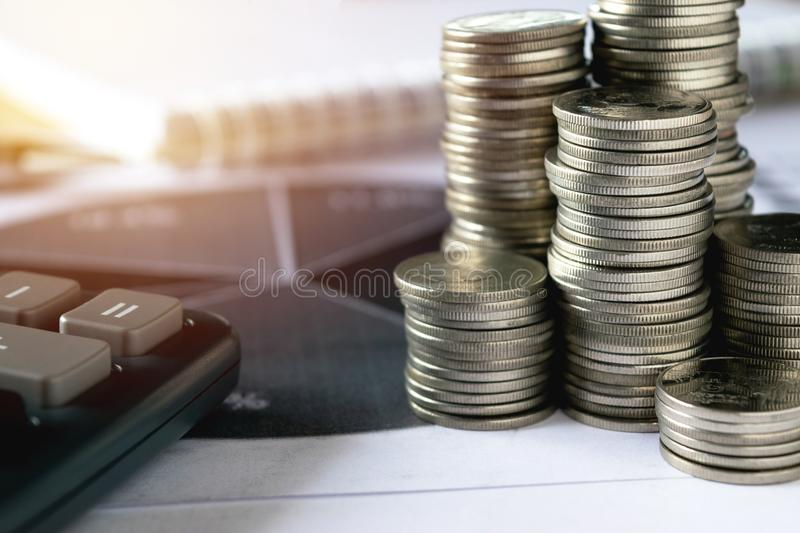 Financial concept, Pen and calculator with coins graph paper o royalty free stock photography