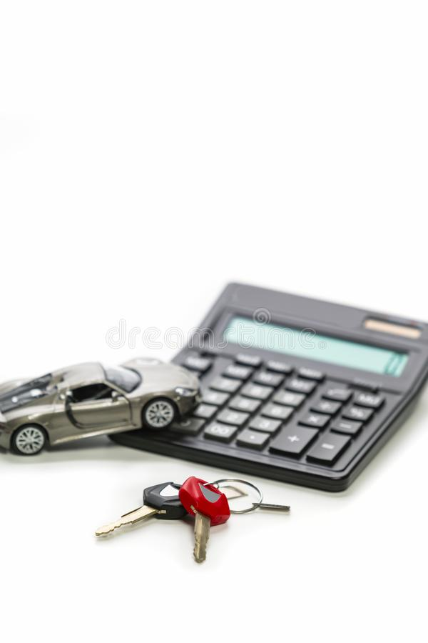Financial Concepts of Car Loans and Credits. Composition of Scale Car and Keys against Calculator on Background. Vertical Orientation stock images