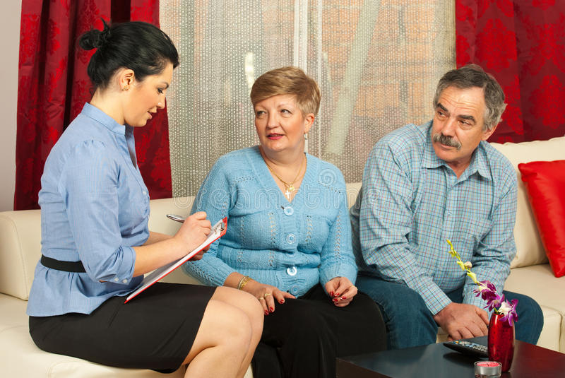 Financial consultant with mature couple stock photos