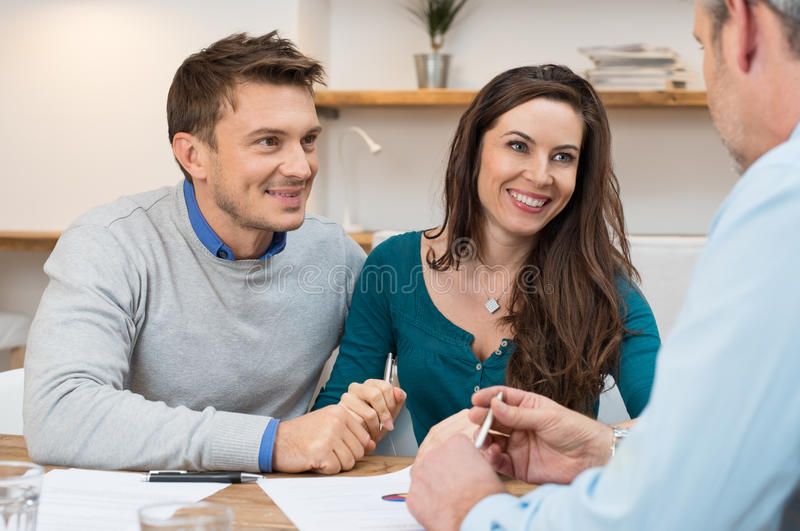 Financial consultation. Young couple meeting financial advisor for investment