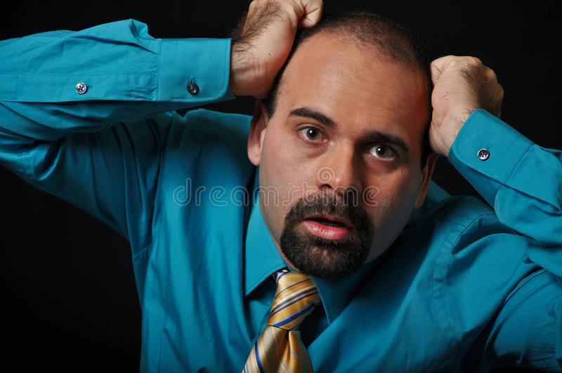 Financial crises. This picture represents a man suffering a financial crises royalty free stock images