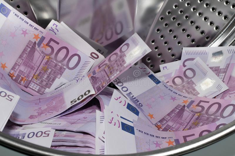 Financial crisis. Money laundering: money in the washing machine. stock photography