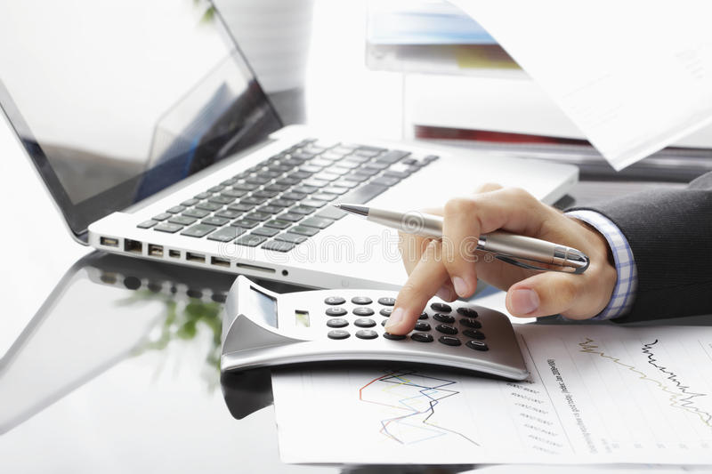 Financial data analyzing. Close-up photo of a businessman analyzing financial data royalty free stock photos