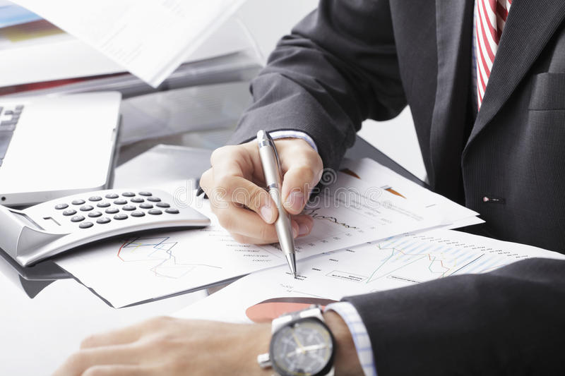 Financial data analyzing. Close-up photo of a businessman analyzing financial data stock image