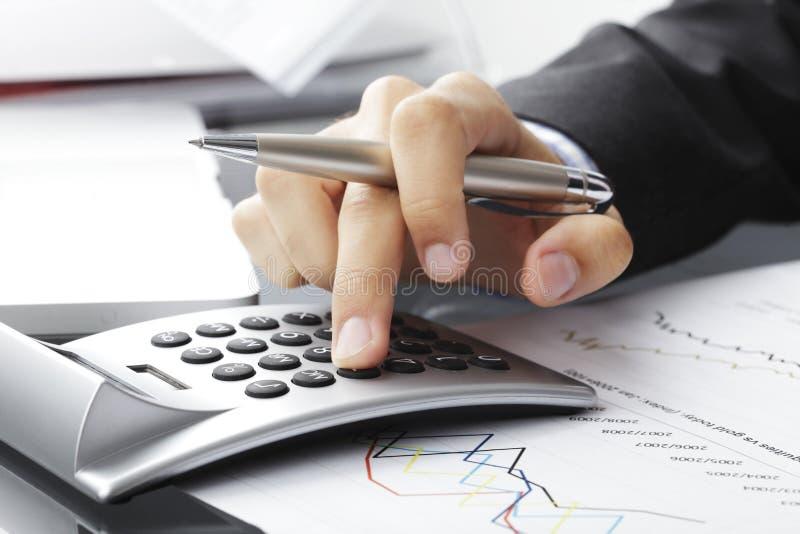 Financial data analyzing. Close-up photo of a businessman analyzing financial data royalty free stock photo