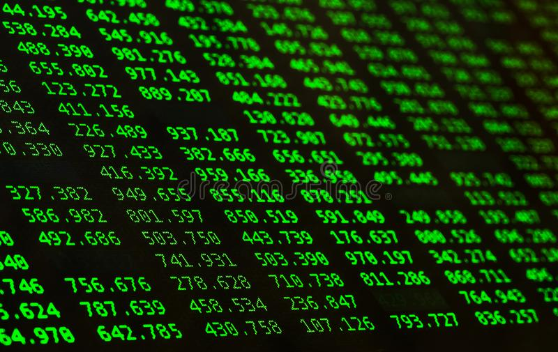 Financial data of green color on a monitor. Finance data concept. Macro royalty free stock photography