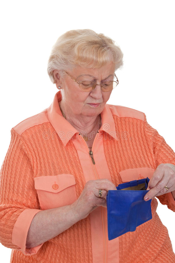 Financial difficulties. Elderly woman looking in her empty purse - isolated royalty free stock image