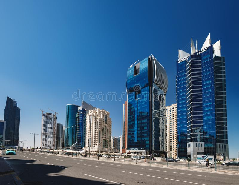 Financial district in Doha, Qatar. Doha, Qatar - March 3, 2018: Panoramic view of the futuristic skyline in the financial district of Qatar is seen from Doha royalty free stock image