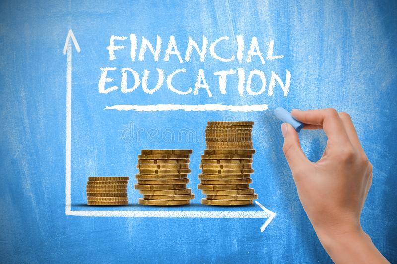 Financial education concept with piles of money and exponential growth chart on chalkboard royalty free stock images