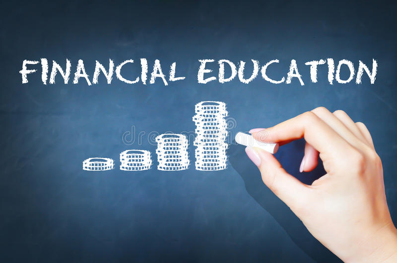 Financial education text on blackboard royalty free stock image