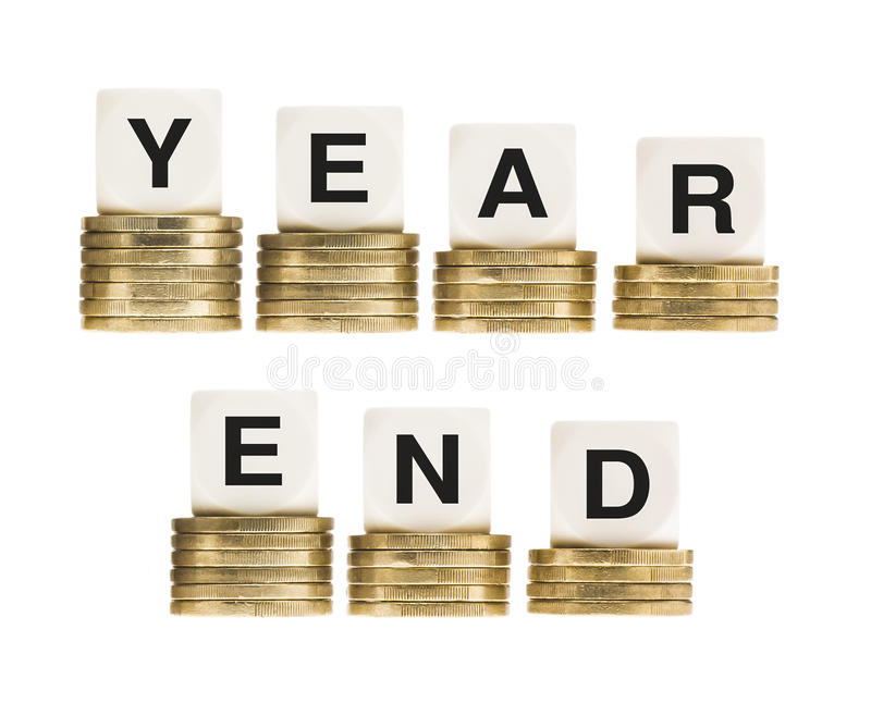 Financial Fiscal Tax Year End on Gold Coins. Financial or fiscal tax year concept. The words Year End on stacks of gold coins indicating the end of the financial stock photography