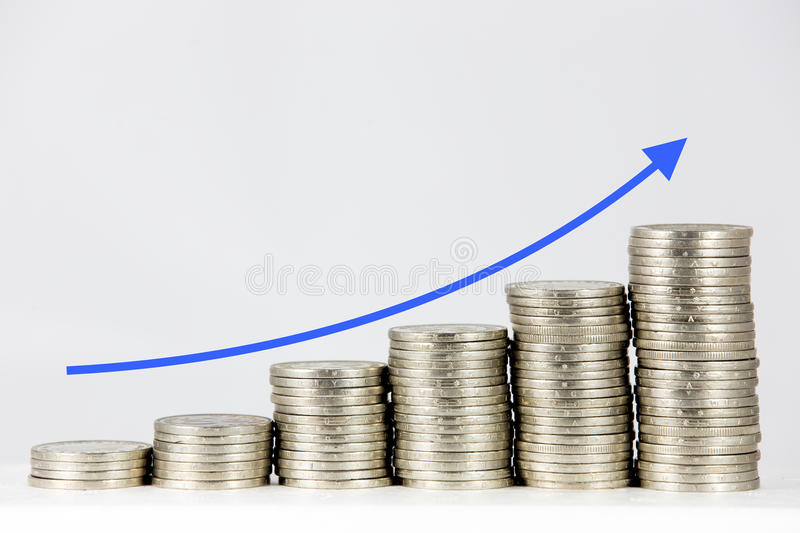 Financial graph with coins royalty free stock photography