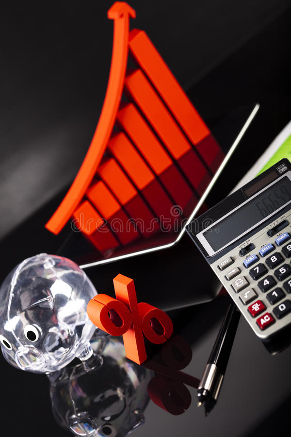 Financial graph on tablet with calculator.  royalty free stock images