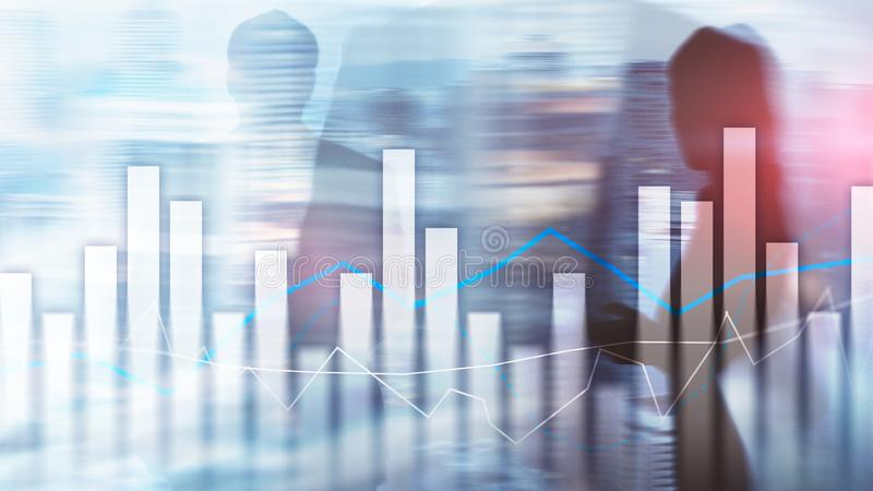 Financial graphs and charts on blurred business center background. Invesment and trading concept. Financial graphs and charts on blurred business center stock images
