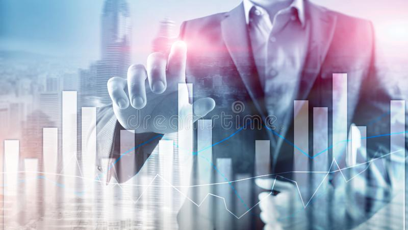 Financial graphs and charts on blurred business center background. Invesment and trading concept.  royalty free stock photos