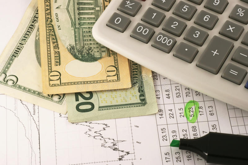 Financial graphs, money and calculator. On the table stock images