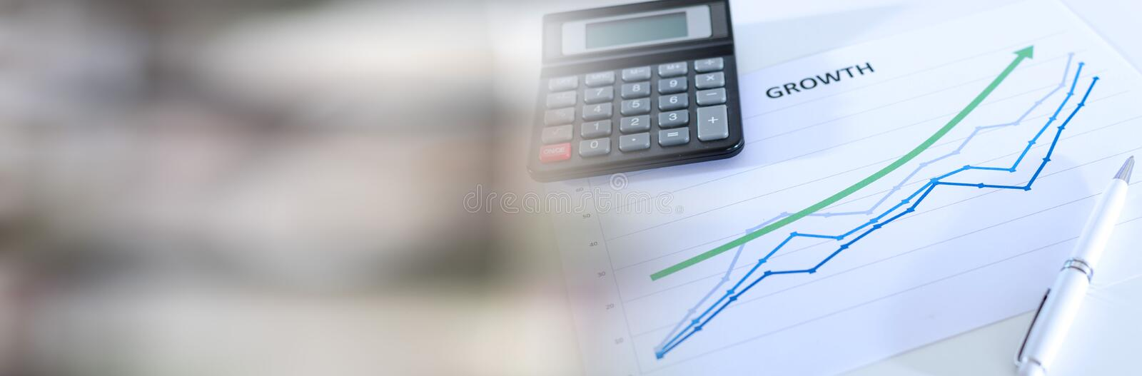 Financial graphs showing growth with calculator. panoramic banner. Financial graphs showing growth with calculator closeup. panoramic banner royalty free stock image