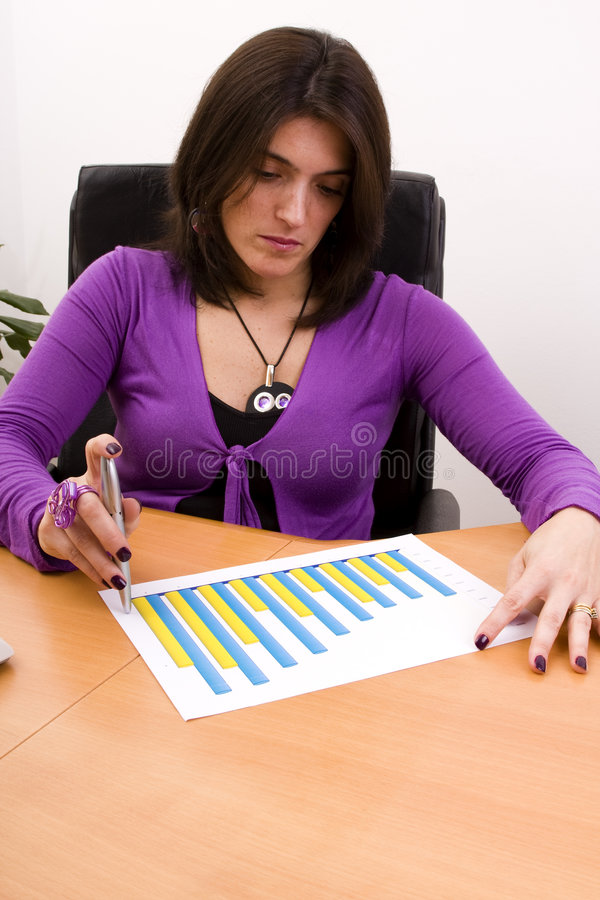 Financial growth. Businesswoman analizing the financial growth at the office desk stock photography