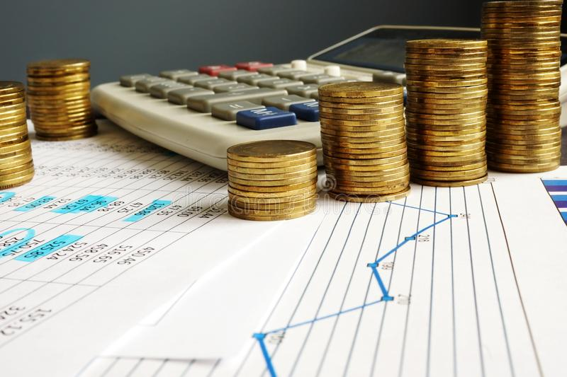 Financial growth and business success. Coins, calculator and charts. royalty free stock images