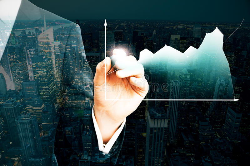 Financial growth concept. Businessman drawing business chart on night city background. Double exposure. Financial growth concept stock photos